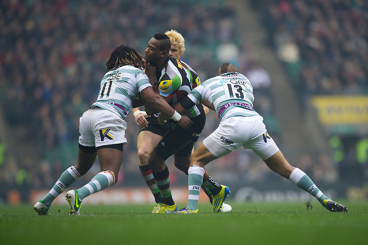 Ugo Monye of Harlequins is tackled by Marland Yarde (left) and Jonathan Joseph of London Irish during the Aviva Premiership match between Harlequins and London Irish at Twickenham on Saturday 29th December 2012 (Photo by Rob Munro).