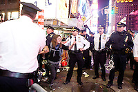 "Protesters with ""Occupy Wall Street"", having been blocked by barricades for the better part of two hours in Times Square are freed by the suddenly accomodating NYPD who decide to let them cross the street on October 15, 2011 in New York City.  While crowd estimates numbered in the tens of thousands, police tactics (including nets, motor scooters, barricades, arrests, and intimidation by riders on horseback) prevented the crowd, which had been split up, from joining together as one in the middle of Times Square.  By the time the NYPD removed some barricades and let protesters join each other their numbers had dwindled significantly as many went to a rally in Washington Square Park rather than wait in Times Square."