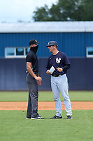 FCL Yankees manager Tyson Blaser (50) questions a call with umpire Chase Eubanks during a game against the FCL Blue Jays on June 29, 2021 at the Yankees Minor League Complex in Tampa, Florida.  (Mike Janes/Four Seam Images)