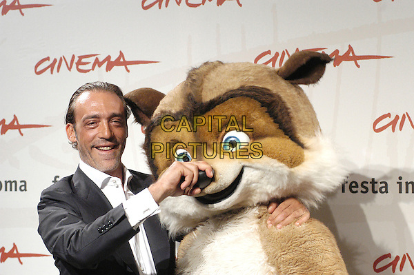 """LUCA WARD.attends a photocall to promote the movie """"La Gand De Bosco"""" on the eighth day of Rome Film Festival (Festa Internazionale di Roma) in Rome, Italy, October 20th 2006..half length funny animal character costume hand on over nose.Ref: CAV.www.capitalpictures.com.sales@capitalpictures.com.©Luca Cavallari/Capital Pictures."""