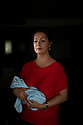 """Spain - Santa Susanna - Portrait of Clara Alfonsa Reinoso, 47. Clara Alfonsa Reinoso had just turned 15 when, on the 18th of June 1987, she gave birth to what she was told was a baby boy at the Institut Dexeus, a top-notch private clinic in Barcelona. The girl came from a troubled family - her mother was a prostitute, her father a heavy-drinker and violent man -  and the local Juvenile Court had just taken legal custody of her and her 9 siblings. Reinoso had spent the previous weeks in a shelter for vulnerable pregnant women, where she had been brought to by a woman who had identified herself as a social worker. On the day of the delivery, the young mothers left the shelter and was put on a taxi a given two tranquilliser pills. She doesn't remember entering the clinic and given birth. """"I was probably sedated"""", she explains. """"When I woke up afterwards and asked for my baby, a female doctor told me the boy was too small and didn't make it"""". Reinoso never asked to see the corpse. """"I believed what the doctor had just told me"""", she continues. """"She was holding my hand and wiping away my tears as I couldn't stop crying"""". <br /> On the 10th of May 2013, she received a phone call from a psychologist from the Government of Catalunya who asked her if, on June 1987, she had given birth to a baby. Reinoso confirmed and told him the boy had died. """"It wasn't a boy and he didn't die. Your daughter is alive and she is looking for you"""", he replied. Reinoso collapsed to the ground, overwhelmed and dizzy."""