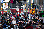 A 4 and a 6 balloon, marking the 46th President, are walked through Times Square as people gather in celebration after former Vice President Joe Biden was declared the winner of the 2020 presidential election between U.S. President Donald Trump and Biden on November 7, 2020 in New York City.  Photograph by Michael Nagle
