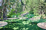 Lawn set up for outdoor banquet with Moment in Time Waterfalls in background.  Ohme Gardens, Wenatchee, Chelan County, Washington, USA.