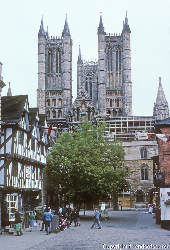 Lincoln: Cathedral--West Towers and entrance to Cathedral Close. Half-timbered house at left is 15th century. Photo '90.