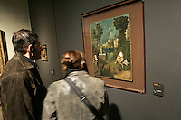 Turisti ammirano il dipinto 'Tempesta' di Giorgione nelle Gallerie dell'Accademia a Venezia.<br /> Tourists admire Giorgione's 'The Tempest' painting in the Accademia gallery in Venice.<br /> UPDATE IMAGES PRESS/Riccardo De Luca