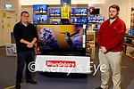Kerry's Eye Fantasy Football winner Johnny Brosnan from Cordal received his prize of a television from competition sponsors Soundstore Tralee on Tuesday. L to r: Jason O'Connor (Kerrys Eye) and Johnny Brosnan.