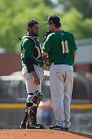 Savannah Sand Gnats catcher Adrian Abreu (24) has a chat on the mound with starting pitcher Ricky Knapp (11) during the game against the Hickory Crawdads at L.P. Frans Stadium on June 14, 2015 in Hickory, North Carolina.  The Crawdads defeated the Sand Gnats 8-1.  (Brian Westerholt/Four Seam Images)