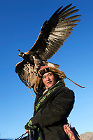 Men with eagles at Altai eagle festival