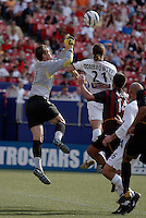 The MetroStars' goalkeeper Jonny Walker punches a ball clear as the Earthquake's Tighe Dombrowski goes up for a header. The San Jose Earthquakes were shut out by  the NY/NJ MetroStars 2-0 at Giant's Stadium, East Rutherford, NJ, on July 10, 2004.