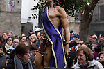 A woman observe of the statue of Saint Sebastian during the Jarramplas Festival inside the church on January 20, 2015 in Piornal, Spain. The centuries old Jarramplas festival takes place annually every January 19-20 on Saint Sebastian Day. Even though the exact origins of the festival are not known, various theories exist including the mythological punishment of Caco by Hercules, a relation to ceremonies celebrated by the American Indians that were seen by the first conquerors, to a cattle thief ridiculed and expelled by his village neighbours. It is generally believed to symbolize the expulsion of everything bad. This year the people who represented Jarramplas were Angel Cerro Fernandez on 19 January and Carlos Calle Rodríguez 47 and Raúl Beites Sánchez 34 on 20 January. (c) Pedro ARMESTRE