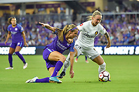 Orlando, FL - Saturday March 24, 2018: Utah Royals Gunnhildur Jonsdottir (23) protects the ball from Orlando Pride midfielder Dani Weatherholt (17) during a regular season National Women's Soccer League (NWSL) match between the Orlando Pride and the Utah Royals FC at Orlando City Stadium. The game ended in a 1-1 draw.