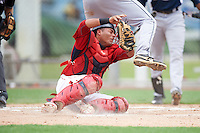 GCL Red Sox catcher Alberto Schmidt (41) tags out Ryan Caldwell at home during the second game of a doubleheader against the GCL Rays on August 9, 2016 at JetBlue Park in Fort Myers, Florida.  GCL Rays defeated GCL Red Sox 9-1.  (Mike Janes/Four Seam Images)