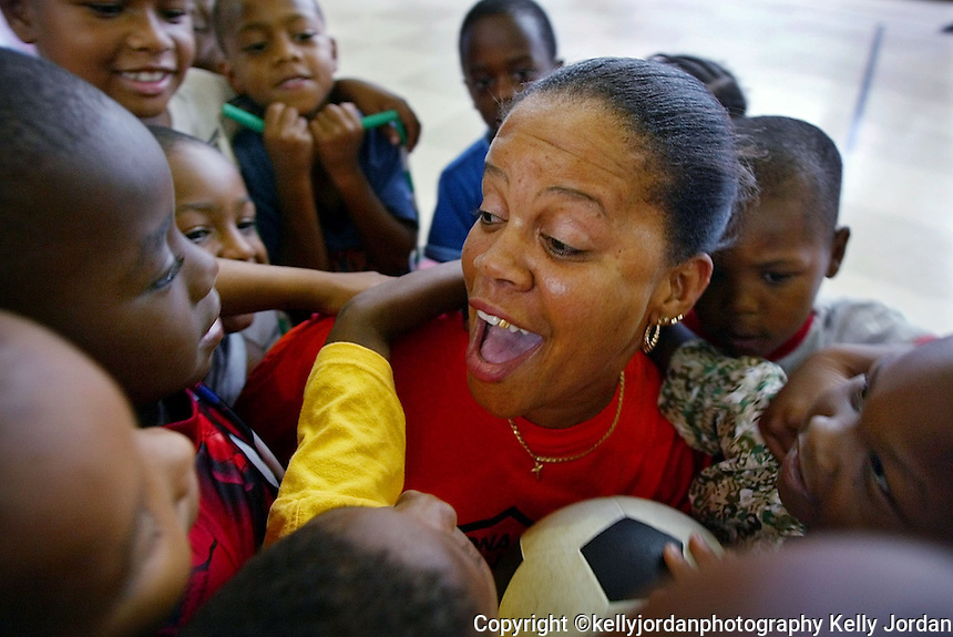 Bonner Elementary School teacher and PAL Program counselor is surrounded by children as they play during a recess at the PAL Center on George W. Ingram Boulevard in Daytona Beach Tuesday June 25, 2002.(Kelly Jordan)..**FOR HENRY SERIES**