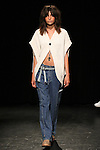 Model walks runway in an outfit from the Linder Spring Summer 2017 collection by Sam Linder and Kirk Millar on July 11 2016, during New York Fashion Week Men's Spring Summer 2017.