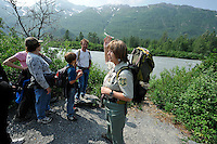 Saralynn Fenwick of the U.S. Forest Service talks about the Placer River behind her. The Alaska Railroad's Spencer Glacier Whistlestop train gives visitors access to hiking, camping and stunning views.