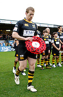 Photo: Richard Lane/Richard Lane Photography. London Wasps v Bath Rugby. LV=Cup. 14/11/2010. Wasps' Tom Rees walks out with a Remembrance Day Wreath.
