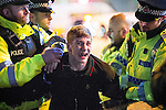 © Joel Goodman - 07973 332324 . 01/01/2016 . Manchester , UK . Police detain a man in handcuffs . Revellers in Manchester on a New Year night out at the clubs around the city centre's Printworks venue . Photo credit : Joel Goodman