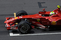 felipe Massa from Brazil in his Ferrari SECONDS BEFORE THE START F1 GRAND PRIX  SEPANG MALAYSIA MARCH 2008, F1 GRAND PRIX  SEPANG MALAYSIA MARCH 2008,  F1 GRAND PRIX  SEPANG MALAYSIA MARCH 2008, FORMULA 1 WINNER IN SEPANG MALAYSIA WAS KIMMI RAIKKONEN from Finland IN HIS FERRARI FIRST PLACE, SECOND PLACE WENT TO ROBERT KUBICA from Poland IN HIS BMW-SAUBER, THIRD PLACE WENT TO HEIKKI KOVALAINEN from Finland IN A MCLAREN.