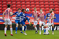 6th February 2021; Bet365 Stadium, Stoke, Staffordshire, England; English Football League Championship Football, Stoke City versus Reading; Michael Olise of Reading controls a high loose ball