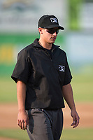 Field umpire JP Perez walks onto the field before a Pioneer League game between the Missoula Osprey and the Grand Junction Rockies at Ogren Park Allegiance Field on August 21, 2018 in Missoula, Montana. The Missoula Osprey defeated the Grand Junction Rockies by a score of 2-1. (Zachary Lucy/Four Seam Images)