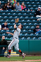 Mark Ginther (9) of the Oklahoma State Cowboys catches a ball in foul territory during a game against the Missouri State Bears at Hammons Field on March 6, 2012 in Springfield, Missouri. (David Welker / Four Seam Images)
