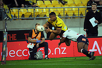 Hurricanes' Julian Savea is tackled into touch before the tryline during the Super Rugby Tran-Tasman match between the Hurricanes and Rebels at Sky Stadium in Wellington, New Zealand on Friday, 21 May 2020. Photo: Dave Lintott / lintottphoto.co.nz