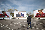 © Joel Goodman - 07973 332324 . 13/04/2015 . Manchester , UK . Conservative Party stunt opposite Old Granada Studios featuring ad vans with Ed Miliband depicted in the pockets of the SNP ahead of Ed Miliband launching the Labour Party manifesto ahead of the General Election at the Old Granada Studios in Manchester , UK . Photo credit : Joel Goodman