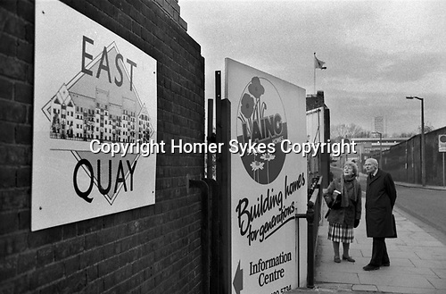 East Quay Canary Wharf area East London 1980s. Signs for Laing building company 1987