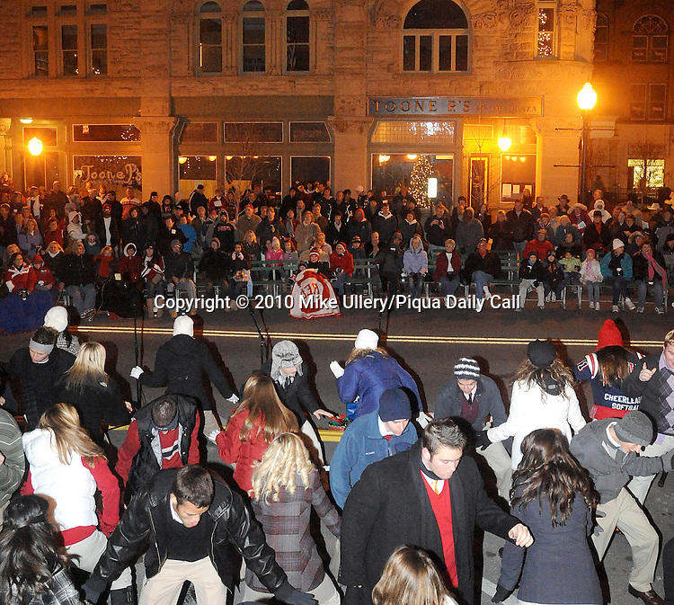 A large crowd gathered in front of the Fort Piqua Plaza as the award-winning Piqua High School Show Choir, The Company, sang and danced during Christmas on the Green in downtown Piqua on Friday.
