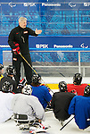 Sochi, RUSSIA - Mar 1 2014 -  Assistant Coach Curtis Hunt  gives instructions to the team during their first practice before the 2014 Paralympics in Sochi, Russia.  (Photo: Matthew Murnaghan/Canadian Paralympic Committee)