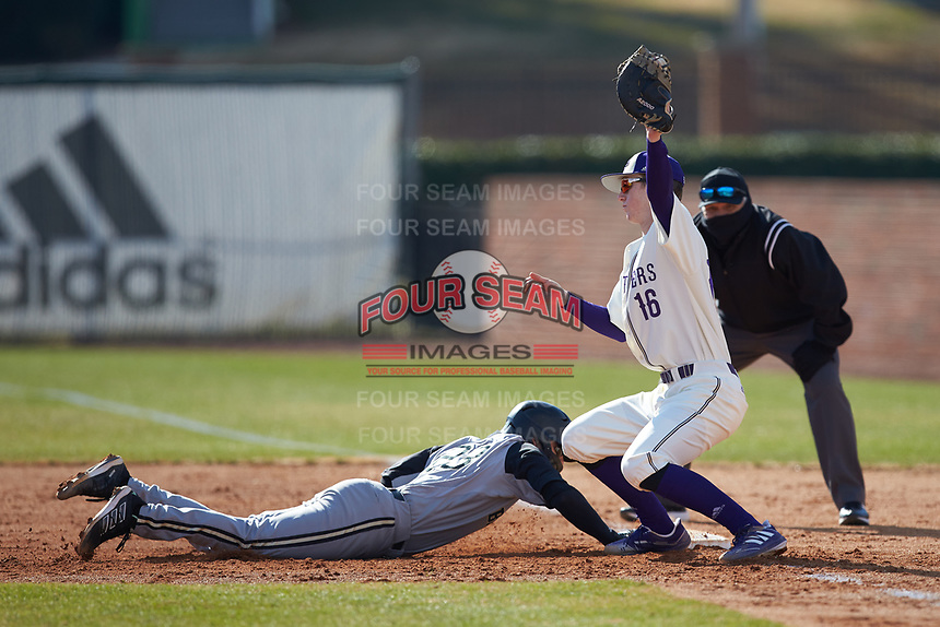High Point Panthers first baseman Cole Singsank (16) reaches for a throw as Matt Woods (23) of the Bryant Bulldogs dives back into the base at Williard Stadium on February 21, 2021 in  Winston-Salem, North Carolina. The Panthers defeated the Bulldogs 3-2. (Brian Westerholt/Four Seam Images)