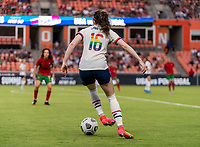HOUSTON, TX - JUNE 10: Rose Lavelle #16 of the USWNT dribbles the ball during a game between Portugal and USWNT at BBVA Stadium on June 10, 2021 in Houston, Texas.