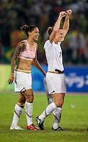 USWNT captain (3) Christie Rampone celebrates with teammate Natasha Kai after playing for the gold medal at Workers' Stadium.  The USWNT defeated Brazil, 1-0, during the 2008 Beijing Olympic final in Beijing, China.