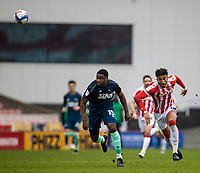 20th March 2021; Bet365 Stadium, Stoke, Staffordshire, England; English Football League Championship Football, Stoke City versus Derby County; Teden Mengi of Derby County and Jacob Brown of Stoke City chase a loose ball