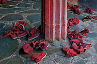 The Monks boots or shoes outside the temple, leaving the boots outside during prayers