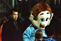 American singer songwriter, composer, Lionel Richie walks around the ground with Wycombe mascot, Bodger meeting fans ahead of kick-off during Wycombe Wanderers vs Notts County, Nationwide League Division Two Football at Adams Park on 6th October 2000