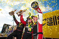 Feb 23, 2020; Chandler, Arizona, USA; NHRA top fuel driver Steve Torrence celebrates alongside pro stock driver Erica Enders after winning the Arizona Nationals at Wild Horse Pass Motorsports Park. Mandatory Credit: Mark J. Rebilas-USA TODAY Sports