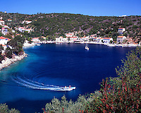 Greece. Ionian Islands. Ithaca. Kioni village. Speedboat in the bay.