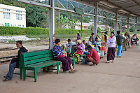 Myanmar, Burma.  Passengers Waiting on the Platform at Kalaw Train Station.