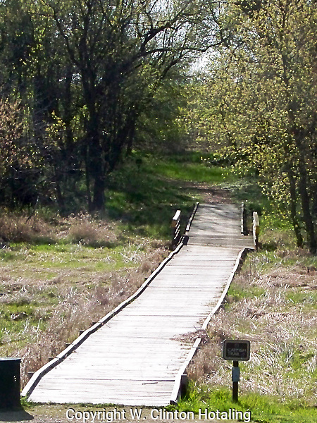 The trail head for the Catfish Trail in DeForest, Wisconsin, leads off into the woods south of town.
