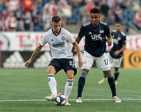 FOXBOROUGH, MA - JUNE 26: Kai Wagner #27 passes the ball as Juan Agudelo #17 defends during a game between Philadelphia Union and New England Revolution at Gillette Stadium on June 26, 2019 in Foxborough, Massachusetts.