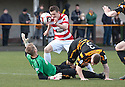 Alloa keeper Scott Bain spills the ball after he collides with team mate Darryl Meggatt to allow Hamilton's Louis Longridge to go on and scores their first goal.