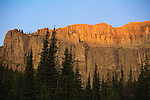 Sunlight just beginning to touch the top of the Chinese Wall in the Bob Marshall Wilderness area in Montana