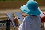 SARATOGA SPRINGS, NY - AUGUST 25: A woman handicaps the races on Travers Stakes Day at Saratoga Race Course on August 25, 2018 in Saratoga Springs, New York. (Photo by Scott Serio/Eclipse Sportswire/Getty Images)