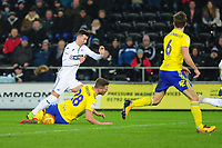 Bersant Celina of Swansea City is tackled by Michael Morrison of Birmingham City during the Sky Bet Championship match between Swansea City and Birmingham City at the Liberty Stadium in Swansea, Wales, UK. Tuesday 29 January 2019