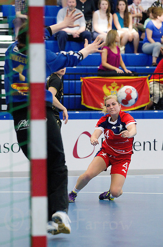 30 MAY 2012 - LONDON, GBR - Zoe Van Der Weel (GBR) of Great Britain (right) shoots during the women's 2012 European Handball Championship qualification match against Montenegro at the National Sports Centre in Crystal Palace, Great Britain .(PHOTO (C) 2012 NIGEL FARROW)