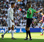 Real Madrid´s Cristiano Ronaldo and referee Alejandro Jose Hernandez during 2014-15 La Liga match between Real Madrid and Eibar at Santiago Bernabeu stadium in Madrid, Spain. April 11, 2015. (ALTERPHOTOS/Luis Fernandez)