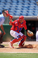 Clearwater Threshers catcher Wilson Garcia (10) looks for a loose ball during a game against the Fort Myers Miracle on April 25, 2018 at Spectrum Field in Clearwater, Florida.  Clearwater defeated Fort Myers 9-5. (Mike Janes/Four Seam Images)
