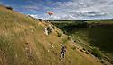 20/07/15<br /> <br /> Chloe Kirkpatrick (22) flies a kite in the sunshine above Lathkill Dale in the Derbyshire Peak District.<br /> All Rights Reserved: F Stop Press Ltd. +44(0)1335 418629   www.fstoppress.com.