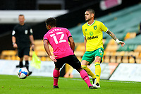 3rd October 2020; Carrow Road, Norwich, Norfolk, England, English Football League Championship Football, Norwich versus Derby; Xavi Quintilla of Norwich City under pressure from Nathan Byrne of Derby County